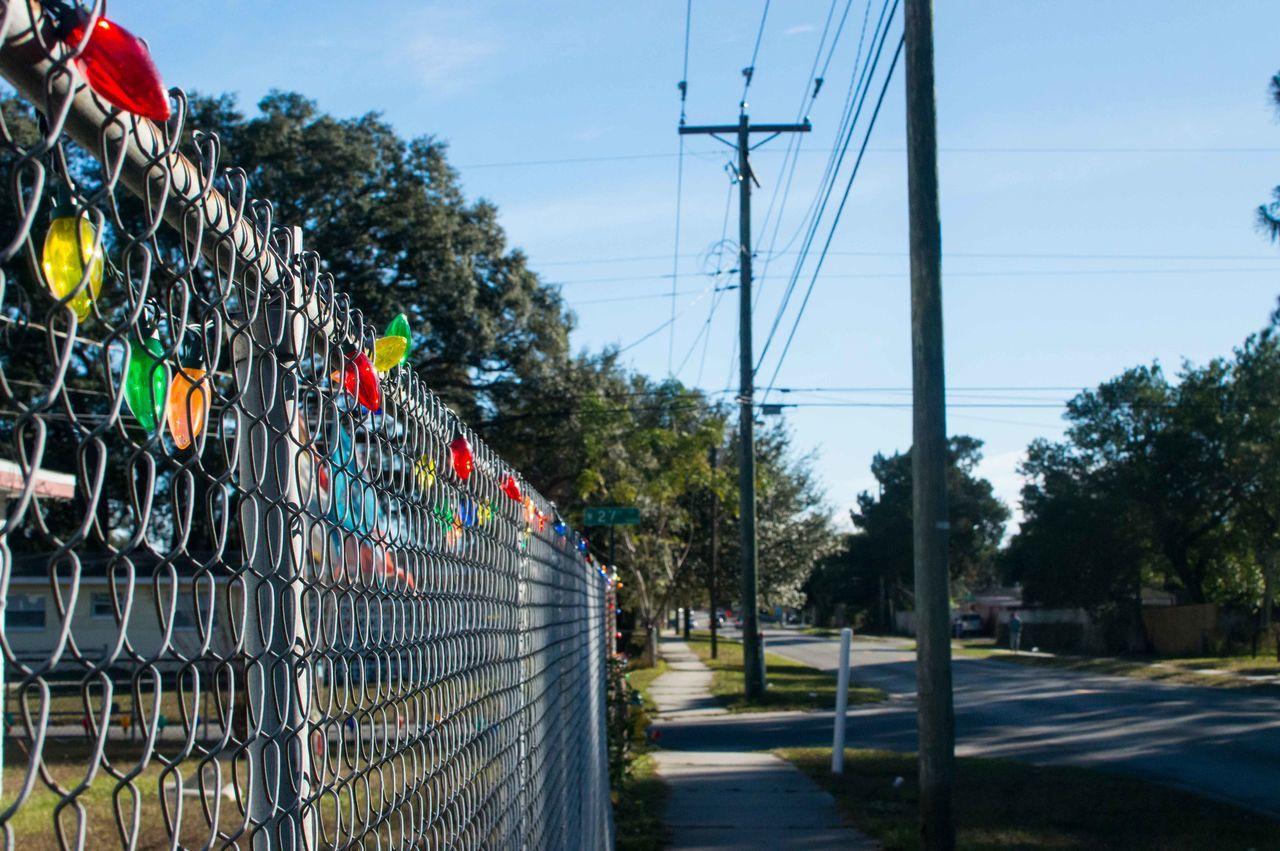 Fence By Sidewalk
