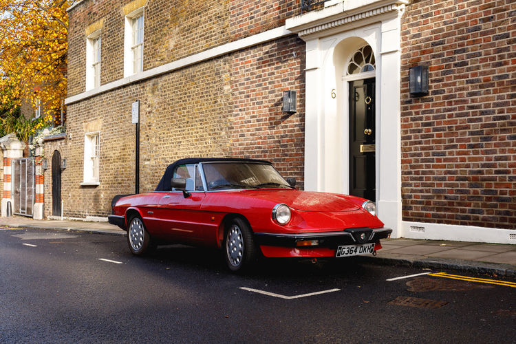 Autumn in London Mode Of Transportation Architecture Car Transportation Motor Vehicle Built Structure Building Exterior Land Vehicle City Brick Brick Wall Street Retro Styled Building Red Vintage Car Day Wall Residential District Luxury Garage London Travel Destinations Autumn Red British Culture