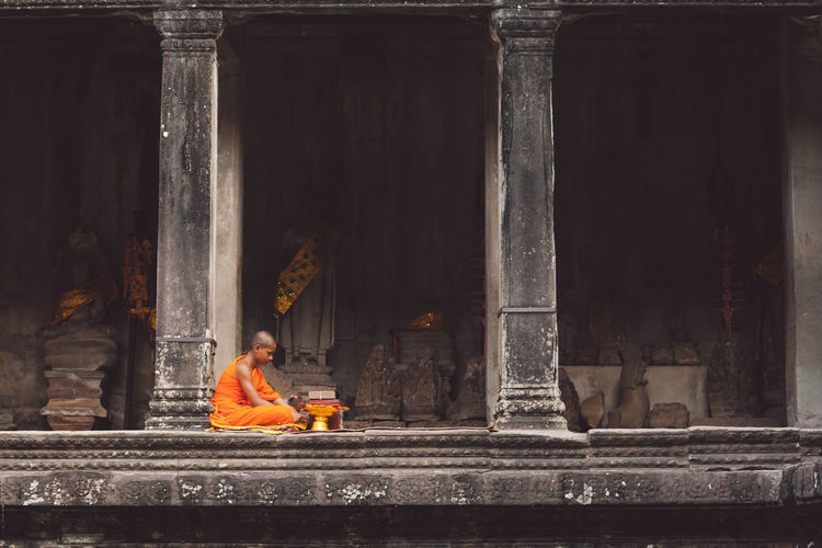Siem Reap Cambodia Angkor Angkor Wat Angkor Wat, Cambodia Sitting Religion Architecture Spirituality Built Structure Belief One Person Place Of Worship Real People Architectural Column Building Adult Day Clothing Indoors