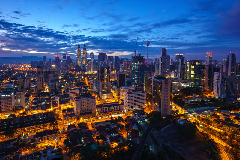 Blue hour dawn, Kuala Lumpur Architecture Blue Building Exterior City Cityscape Cloud - Sky Downtown District Growth High Angle View Modern Night No People Outdoors Sky Skyscraper Travel Destinations Urban Skyline