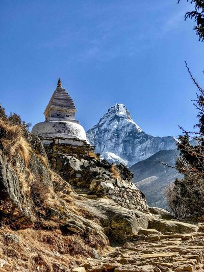 Everest Base Camp Trek Nepal - stupa with Ama Dablam in the background Cold Temperature Landscape Mountain Mountain Peak Religion Sky Snowcapped Mountain Spirituality