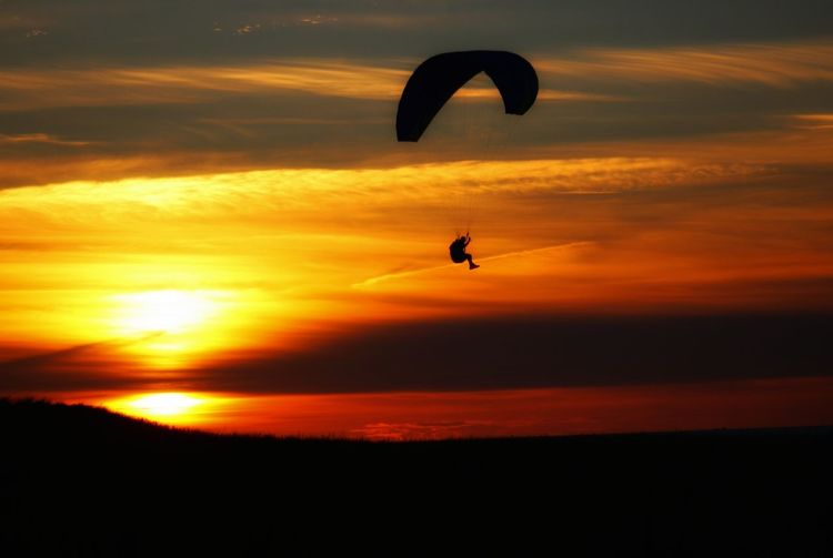 amazing kiters with the spectacular sunset Be Brave Photojinicphotography Denmark Kitersurfer Paragliding Parachute Extreme Sports Flying Sunset Adventure Sport Mid-air Silhouette Full Length Gliding Fly Parasailing