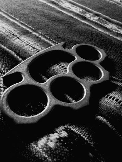 Close-up of brass knuckle on carpet