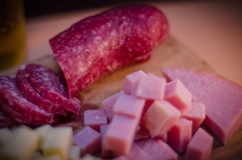 Close-up of sliced and chopped meat on cutting board