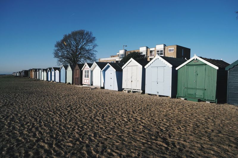 Nice beach huts on the beach Sand Sunlight In A Row Clear Sky EyeEmNewHere Built Structure Outdoors Nature Architecture Beach Hut Sea Mersea Ocean