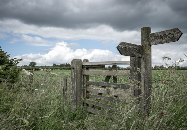 Cloud - Sky Cloudy Countryside Uk Directional Sign Field Footpath Sign Gate Idyllic Landscape Nature No People Outdoors Rambling Sky Tranquility Walking Waymarker Wood - Material