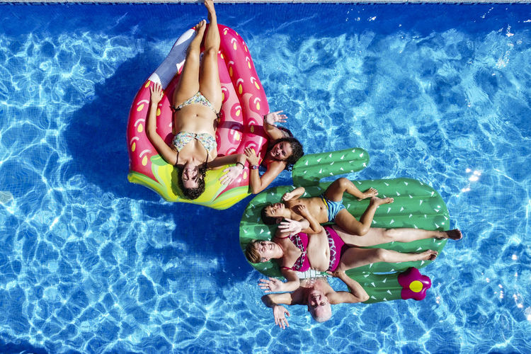 High angle view of people enjoying in swimming pool