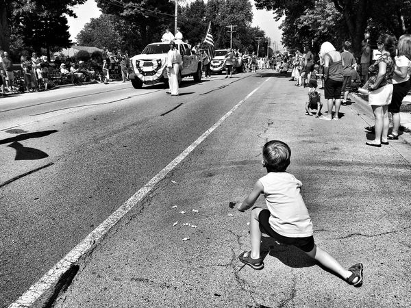 Boy picking up candy at a paradeEyeEm Best Shots - Black + White Black&white Black And White Photography Blackandwhite Photography America Americana Childhood Memories Summer Summertime Parade Parade Time Parades Blackandwhite Black And White Black & White Kids Being Kids Children Photography Child Boy Childhood Kids Having Fun Having Fun Kids Son Forth Of July