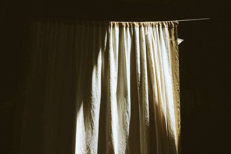 Curtain in shadow Indoors  Curtain Window No People Home Interior Textile 17.62° Hanging Close-up Pattern Wall - Building Feature Day Domestic Room Still Life Sunlight Blinds