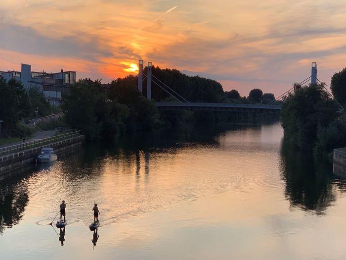 Scenic view of river against orange sky