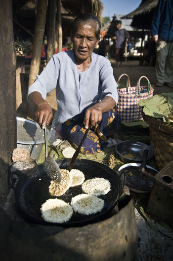 Been There. Done That. EyeEmNewHere Food And Drink Hello World Travel Photography Adult Burma Day Food Freshness Front View Inle Lake Men Myanmar One Person Outdoors People Real People Senior Adult Sitting Streetfood Streetfood Worldwide Streetphotography Travel Destinations