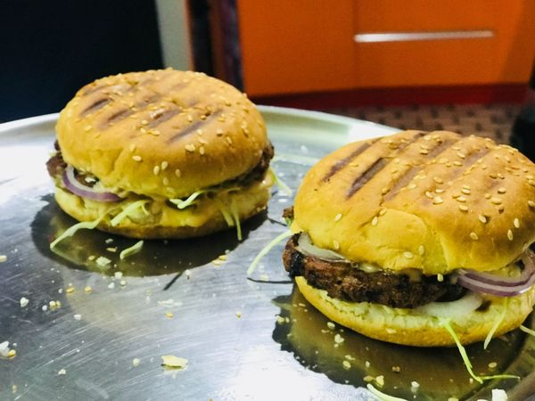 Anyone for burger treat !? Patty Eat Hamburger Burger Food And Drink Indoors  Food Unhealthy Eating Bun Table Ready-to-eat Close-up Indulgence No People Sesame Seed Fast Food Freshness Day