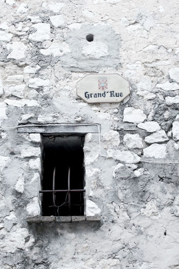 Architecture Built Structure Window Wall Text Old Western Script Building Stone Wall Close-up Sign Grand Rue Grid France
