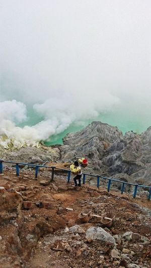 """ among visitors :) Ijen Crater On The Way Hidden Gems  Sulfur Miners Stairways Holiday POV Penambang Belerang Kawah Ijen Connected With Nature Finding Sulfur Colour Of Life Live For The Story"