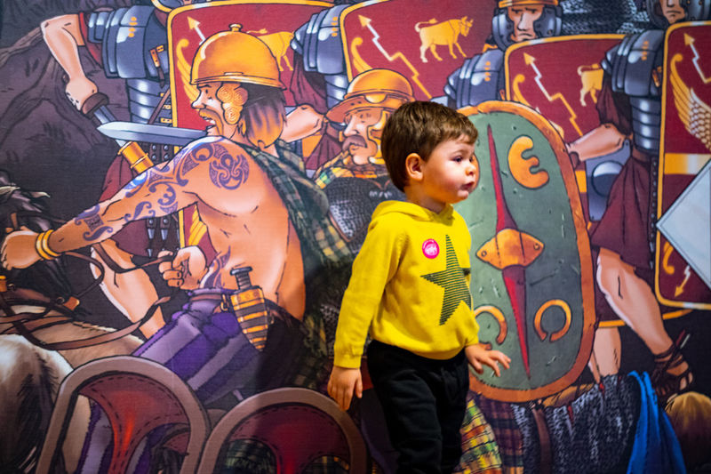 Little boy in front of the wartime illustration at the Museum of London Men Childhood Boys Child Males  Real People Leisure Activity Representation Casual Clothing Innocence Illustration Museum Of London