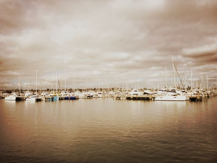 Sailboats Moored In Sea Against Sky
