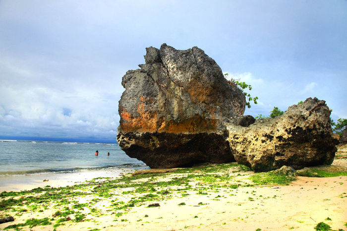 two big rocks on the beach Bali Beach Beauty In Nature Cloud - Sky Horizon Over Water Nature Outdoors Rock Formation Sand Scenics - Nature Sea Sky Stack Rock Tourist Destination Tranquil Scene