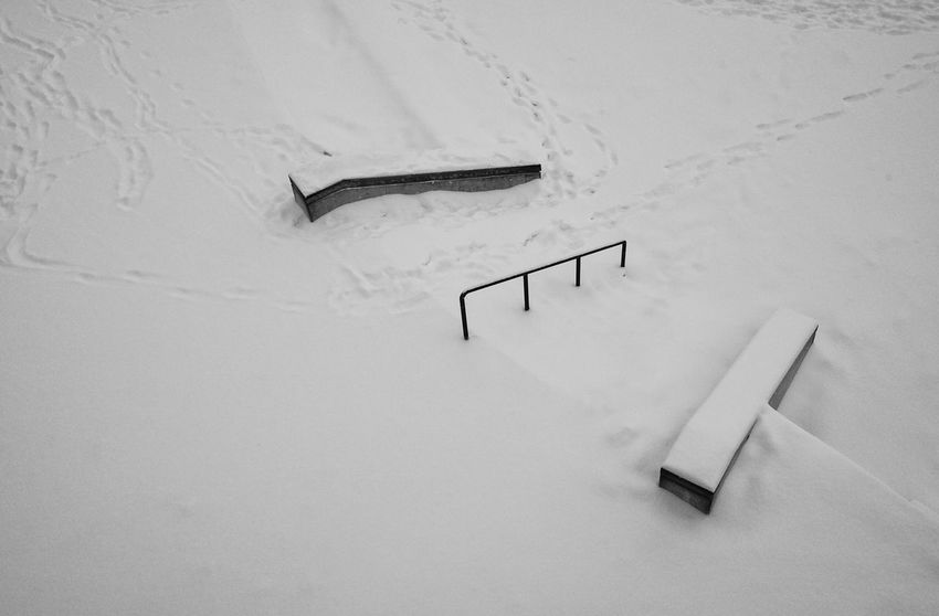 No skateboarding here. Black And White Shades Of Winter Railing Rails Snow Covered Skate Park White Color No People High Angle View Day Close-up