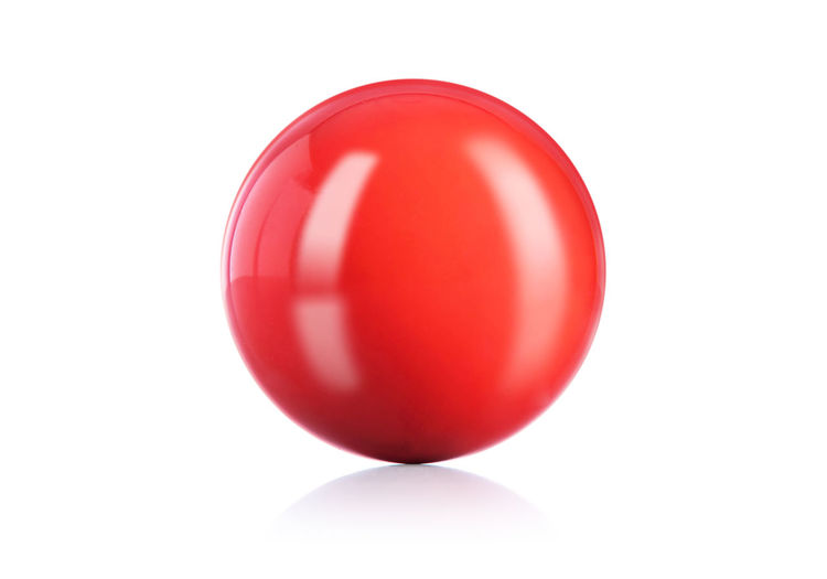 Close-up of red ball against white background