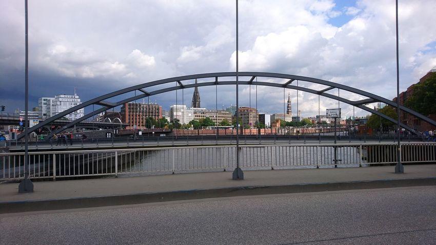Bridge view. Hamburg Hh Germany Hansestadt Hansestadt Hamburg Speicherstadt Historic Skyline Cityscape Clouds Clouds And Sky Asphalt City Cityscape Arts Culture And Entertainment Bridge - Man Made Structure