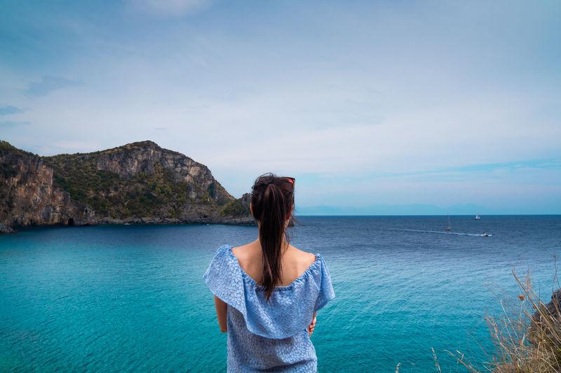 Girl admiring a seascape on the cilento coast
