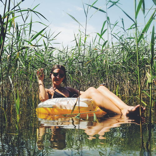 Leisure Activity One Person One Woman Only Day Outdoors Nature Summer Water Lifestyles Relaxation Vacations Young Adult Sky Young Women Grass Perspectives On Nature An Eye For Travel Going Remote