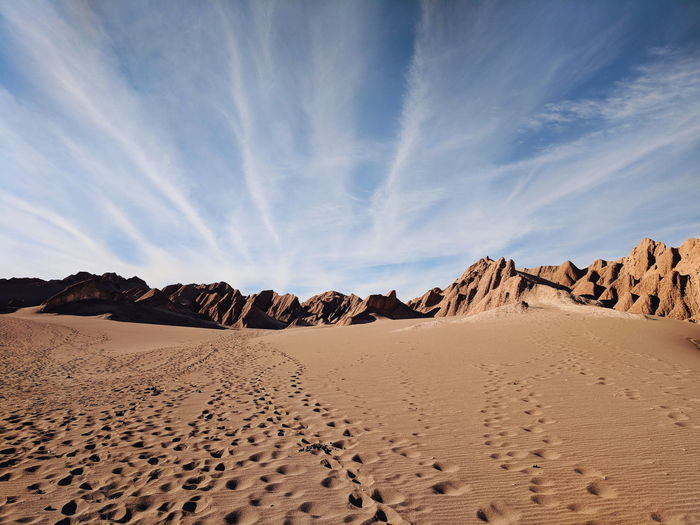 Arid Climate Atmospheric Beauty In Nature Climate Cloud - Sky Day Desert Environment Land Landscape Nature No People Non-urban Scene Remote Sand Sand Dune Scenics - Nature Sky Sunlight Tranquil Scene Tranquility 2018 In One Photograph