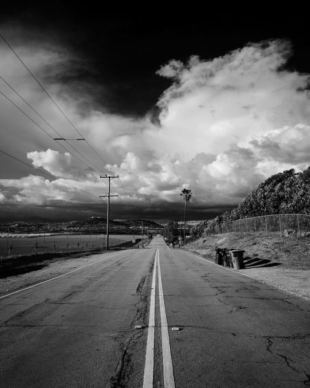 Empty road against sky