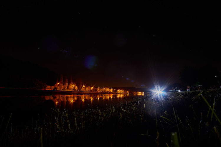 Night on river Moselle Night Water Nature Light Sky Landscape Light Trails Glowing Illuminated Grass Tranquility Dark Long Exposure Plant Astrophotography Scenics Beauty In Nature No People Idyllic Tranquil Scene Lens Flare Lighting Equipment Light Beam Reflection Lake Outdoors Transportation Built Structure Light - Natural Phenomenon