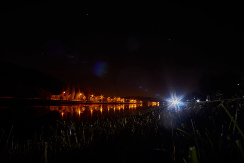 Night on river Moselle Astrophotography Beauty In Nature Dark Glowing Grass Idyllic Illuminated Landscape Light Light Trails Long Exposure Nature Night No People Plant Scenics Sky Tranquil Scene Tranquility Water