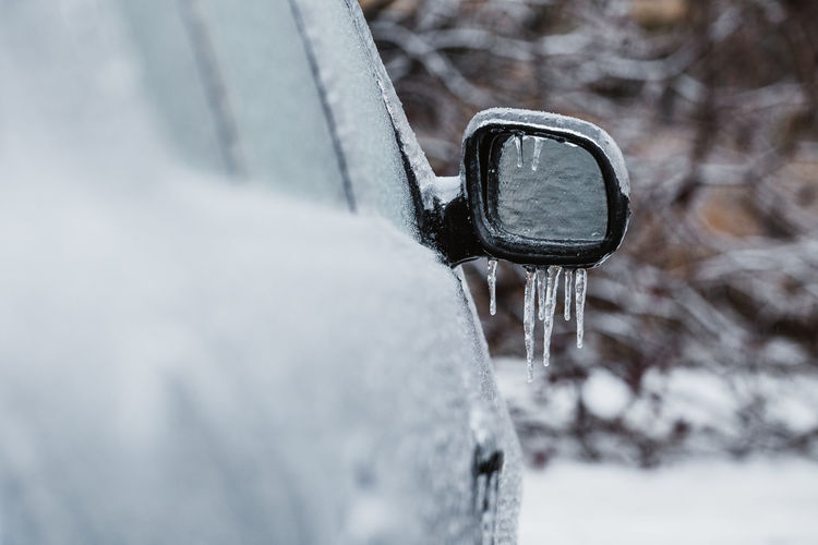 Close up of a car side mirror covered with ice and icicles Snow Winter Cold Temperature Day Nature Frozen Selective Focus Close-up Environment No People Outdoors Motion Focus On Foreground Ice Covering Snowing Non-urban Scene Extreme Weather Transportation Icicle Side Mirror Icicles Hanging Freezing Rain Frost Ice