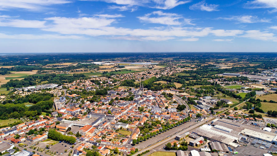 Aerial view of Machecoul city in Loire Atlantique, France France Panorama Aerial Photography Aerial View Architecture Building Exterior Built Structure City Cityscape Cloud - Sky Countryside Day Drone Photography French Landscape Loire Atlantique Machecoul Outdoors Residential District Town