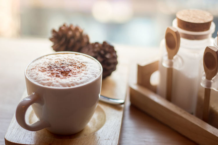Close-up of cappuccino on table