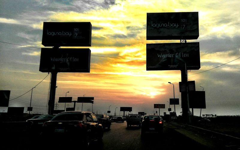 Car Sunset Cloud - Sky Road Sign Transportation Traffic Land Vehicle Dramatic Sky Sky Outdoors Street City Street Road Mode Of Transport City Egyptdailylife Stoplight No People Day Oil Pump This Is Egypt ❤ Travel Destinations Scenics City Arts Culture And Entertainment