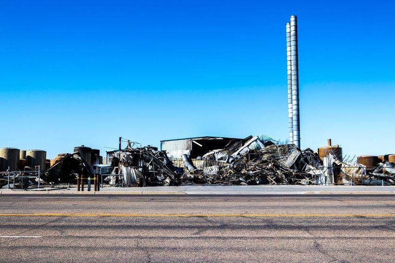 Burnt Fire Clear Sky Blue Junkyard Abandoned Copy Space Obsolete Industry Scrap Metal Outdoors