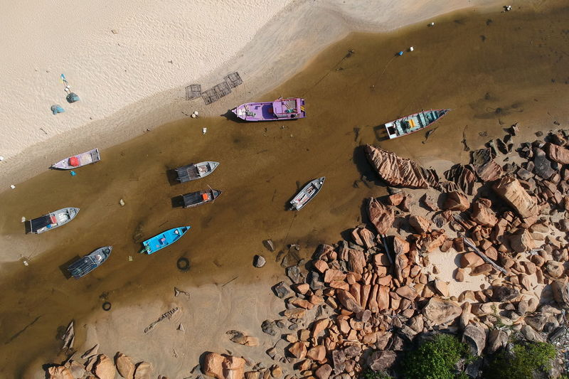 Abundance Architecture Beach Built Structure Day Dry Environment High Angle View Land Large Group Of Objects Mode Of Transportation Nature No People Outdoors Rock Sand Scenics - Nature Transportation Water