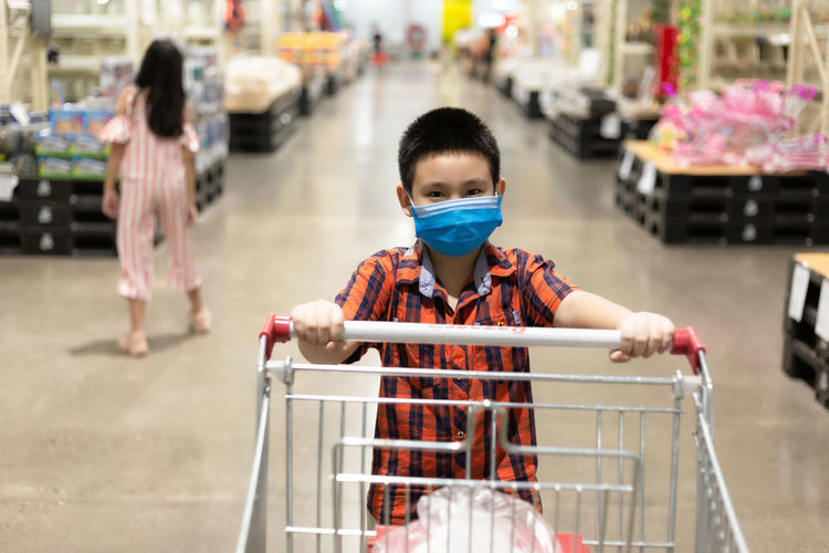 Portrait of boy shopping in store