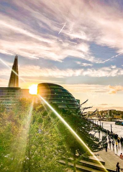 Rayz on sunny London days City Hall Shard United Kingdom Uk LONDON❤ London Travel Photography Travel Destinations Travel Street Photography Street ShotOnIphone Mobilephotography IPhoneography Sky Sunlight Nature Lens Flare Cloud - Sky Sunset Sunbeam Sun Building Exterior Architecture Built Structure