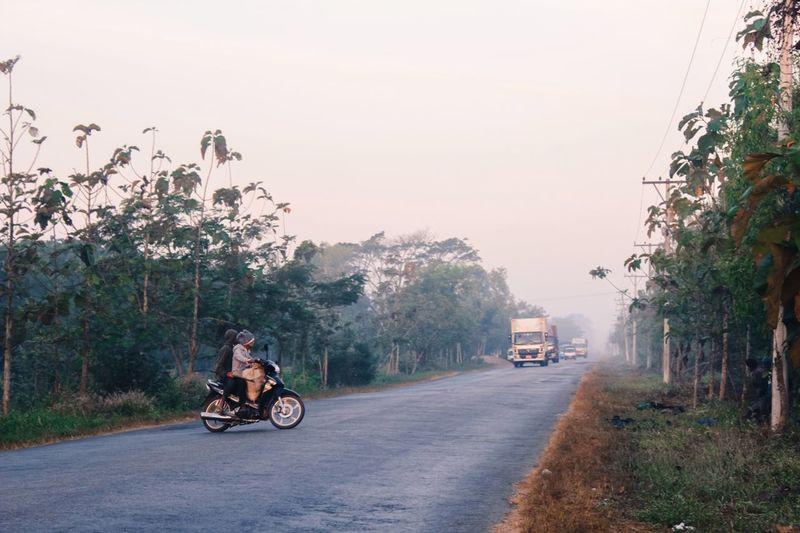 Men Riding Motorcycle On Street