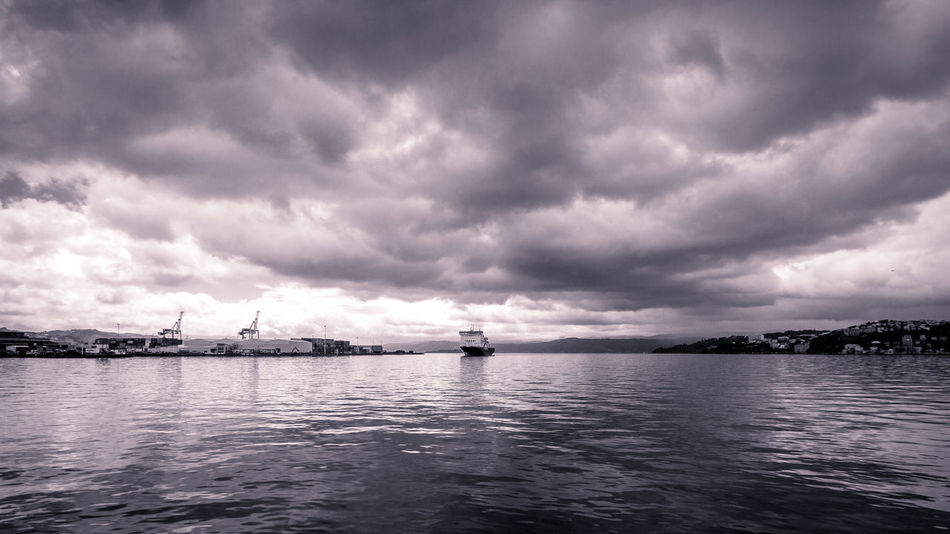 Shipped to the South 16x9 Black And White Cloud Cloud - Sky Cloudscape Cranes Ferry Harbour View Marlborough Sounds New Zealand North Island Overcast Sky Storm Cloud Storm Clouds Vessel Water Waterfront Weather