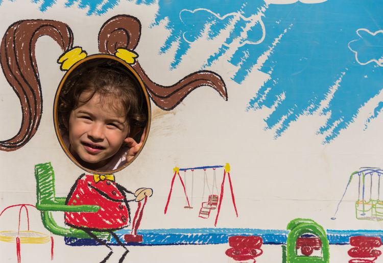 Full length of cute baby girl against graffiti wall