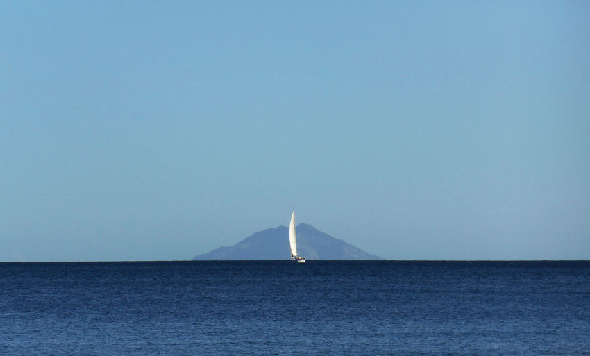 sailing in the mediterranean sea Sailboat Sailing Sky Sea Island Blue Nature EyeEm Nature Lover Horizon Over Water Clear Sky Water