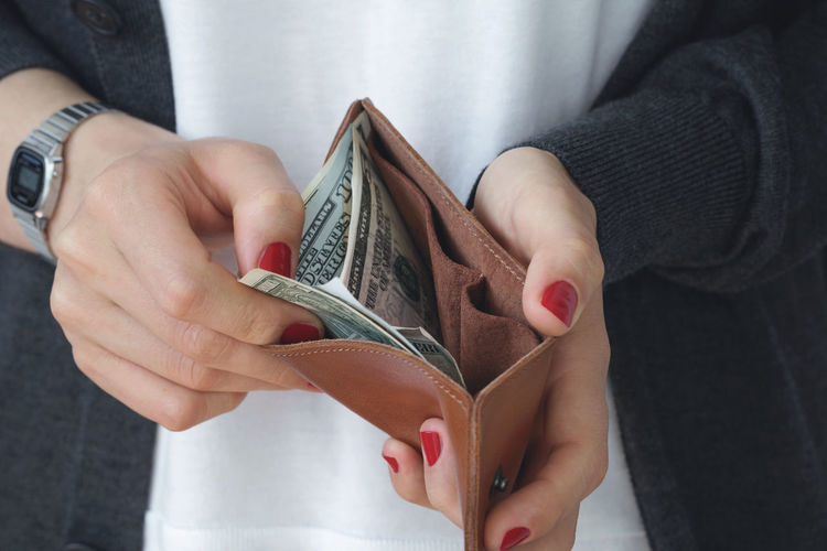 Midsection Of Woman Holding Wallet