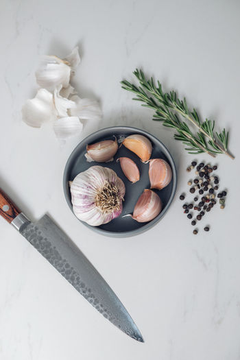 Garlic, Rosemary, Peppercorns and a Knife on white marble. Cooking Garlic Herb Herbs Knife PEPPERCORN Peppercorns Rosemary Day Food Food And Drink Food Stories Freshness Garlic Bulb Garlic Clove Healthy Eating High Angle View Indoors  Lay Flat No People Pepper Spice Spices Still Life White Marble