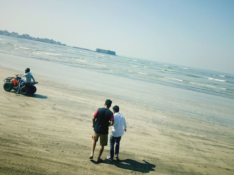 Enjoy The New Normal Beach Sea Two People Togetherness Real People Rear View Lifestyles Horizon Over Water Leisure Activity Outdoors Day Women Vacations Adult Sand Men Senior Adult People Beauty In Nature Baby Stroller Finding New Frontiers Miles Away The City Light
