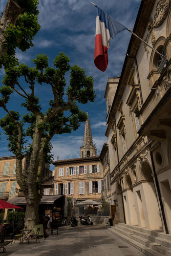 Architecture Building Exterior Built Structure City Day France French Flag History Lavender Street Low Angle View No People Outdoors Place Of Worship Provence Provence-Alpes-Cote D'Azur Religion Sky Spirituality St Remy Street Tree Village