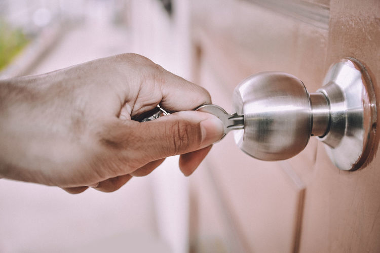 Adult Body Part Close-up Door Finger Focus On Foreground Hand Holding Human Body Part Human Finger Human Hand Indoors  Key Lifestyles Men Metal One Person Opening Real People