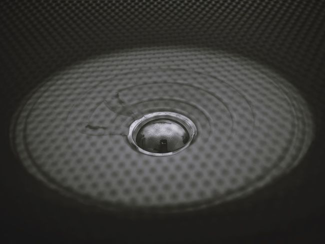 Circle Geometric Shape Shape Indoors  Close-up No People Pattern Metal Directly Above Household Equipment Backgrounds High Angle View Technology Design Full Frame Textured  Sink Selective Focus Shiny Silver Colored Black Background Steel
