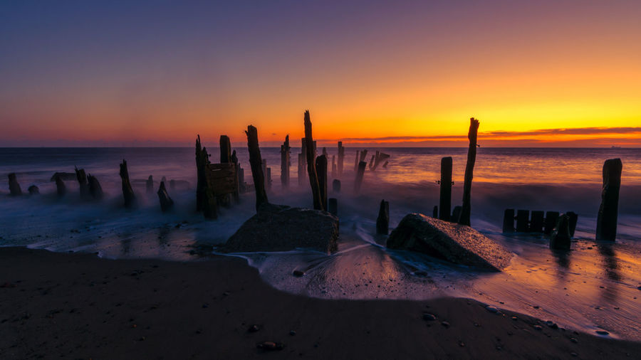 Old Spurn Point beach sea defences at sunrise Holiday Spurn Point Yorkshire Sunlight Beach Beauty In Nature Coast Coastal Golden Hour Groynes Horizon Over Water Nature No People Sand Scenics Sea Sea Defences Shore Sky Spurn Point Sunrise Tide Tranquil Scene Tranquility Vacation Water first eyeem photo