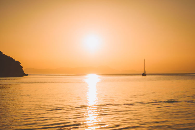 Lost In The Landscape Beach Beauty In Nature Horizon Over Water Idyllic Nature Nautical Vessel No People Outdoors Reflection Sailboat Sailing Scenics Sea Silhouette Sky Sun Sunlight Sunset Tranquil Scene Tranquility Travel Destinations Vacations Water Waterfront Yacht